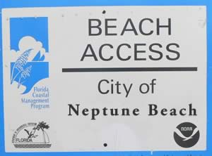 signs designating neptune beach access points