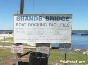 sign at old shands bridge fishing pier