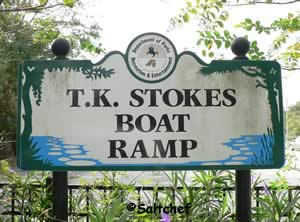 T K stokes boat ramp entrance sign
