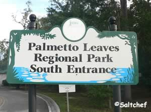 entrance sign to palmetto leaves south