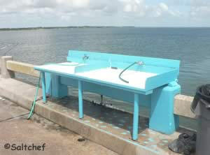 fish cleaning table at george crady fishing pier