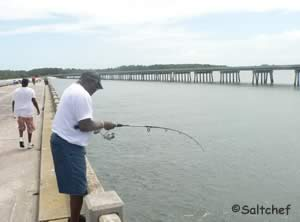 fisherman on george crady fishing pier