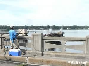 tom fishing at the old bridge