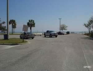 Vehicle with trailer parking at sanders beach ramp