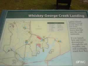 informational sign at whiskey creek landing eastpoint florida