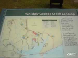 informational sign at whiskey creek landing eastpoint florida