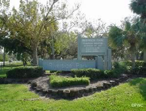 riverside park and boat ramp entrance sign