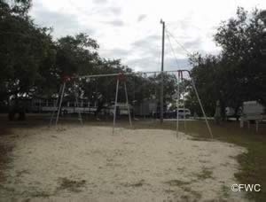 playground swings at shell mound park
