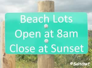guana beaches sunset close sign