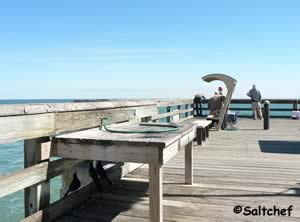 fish cleaning table at pier in st augustine beach