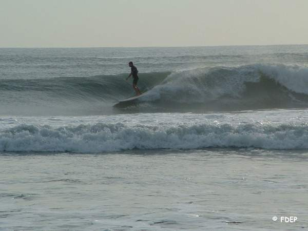 surfing at fort pierce inlet