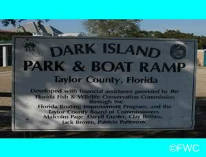 dark island park and boat ramp entrance sign