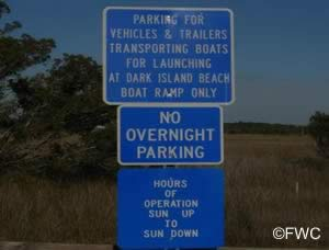 signs at dark island park and boat ramp