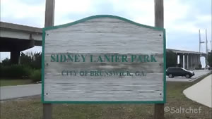 entrance sign to the sidney lanier pier under bridge brunswick, ga