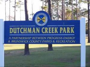 sign at dutchman creek park oak island nc