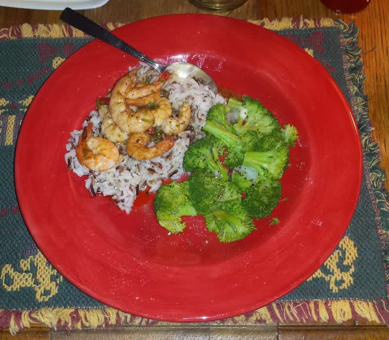spicy baked shrimp with rice and vegetable